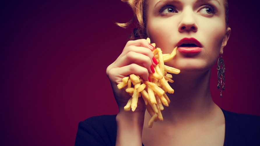Woman-holding-French-fries